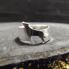 This was an unusual commission to design a ring which incorporated a wolf in it. From one piece of solid sterling silver I hand sawn and formed a wolf. The finishing touch was hand engraved details to bring it (almost) to life.
