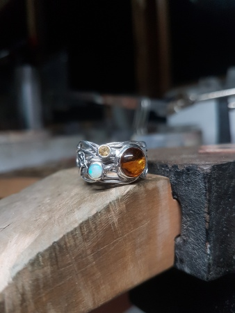 Amber, opal, citrine and wrapped sterling silver ring. A variation on a previous design. This beautiful gemstone combination was chosen by the client .