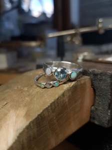 Topaz, opal and sterling silver rings. These two were made specially for a client and her granddaughter. Made to order, ring size and gemstones colour and size are chosen by client.